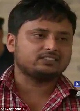 Pained: Faysal Kabir Mohammad Himon speaks to the cameras outside Bellevue hospital today as he gave a brief press conference to point the finger of blame at the cyclist involved in Tuesdays horror smash and apologized to 23-year-old Sian Green