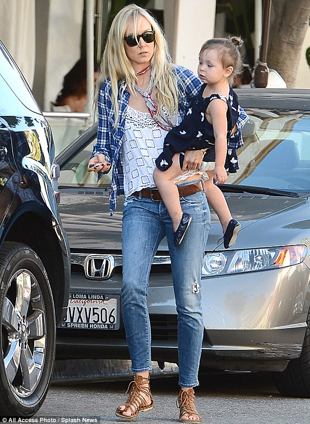 Unique: Kimberly Stewart and her daughter Delilah showed their differences as they stepped out in Beverly Hills, California on Friday