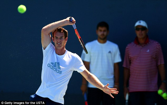 Second home: Andy Murray back on court at Flushing Meadows practising