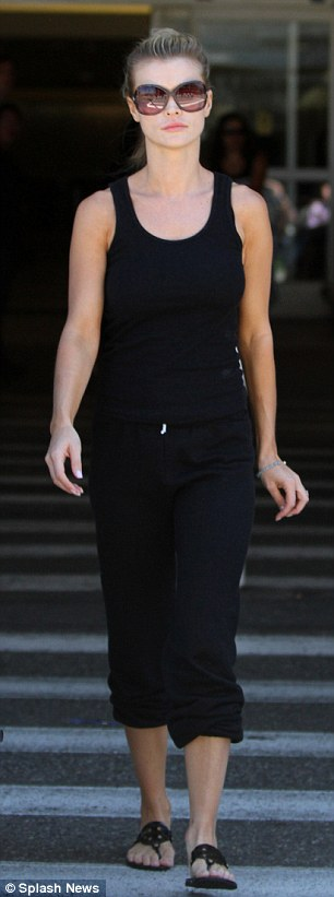 Back to black: The star looked slimline in the casual gear, making sure that her ring was the main focus