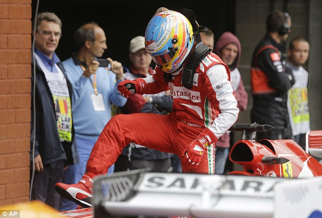 Penny for your thoughts: Ferrari's Fernando Alonso leaves his car - he starts the race in ninth
