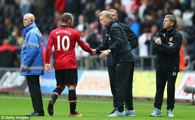 Under the microscope: Rooney's relationship with United manager David Moyes has been scrutinised