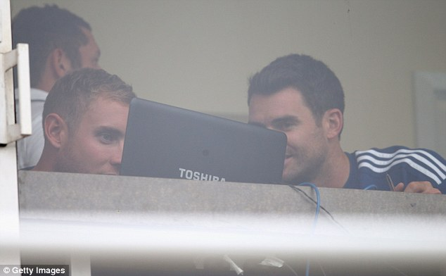 Raining champions: Anderson (right) and Stuart Broad entertain themselves as the weather ruins day four at The Oval