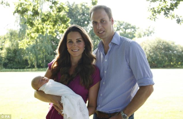 First family home: The Duke and Duchess of Cambridge pictured with their son Prince George in the garden of the Middleton family home in Bucklebury, Berkshire, are scheduled to move to Kensington next month