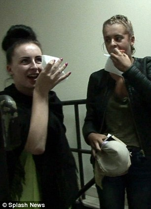 Relief: The girls were pictured eating food and looking happy and smiling shortly after they were arrested