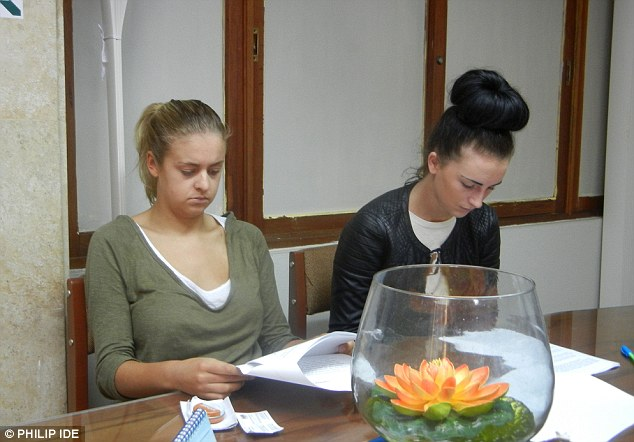 Making their statements: In Lima prosecutor's office, Melissa Reid, left, and Michaella McCollum Connolly check their testimonies to Peruvian police