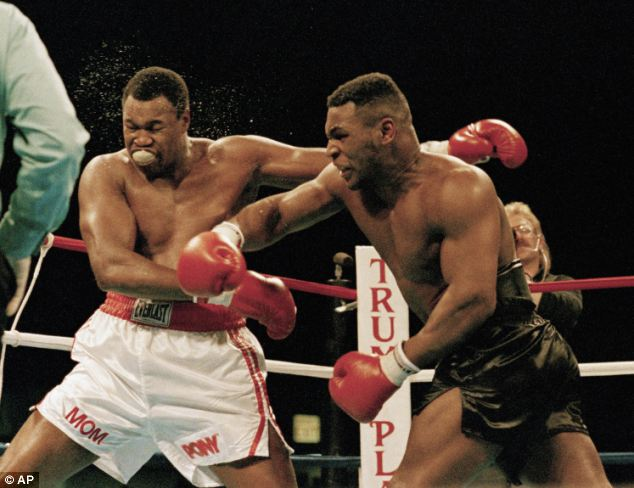 Glory days: He is pictured landing a punch on Larry Holmes in January 1988 during a heavyweight title boxing fight in Atlantic City, New Jersey. He has been in and out of rehab since