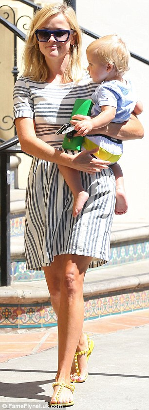 Matchy-matchy: Reese dressed Tennessee in striped shorts that matched her striped frock almost perfectly for their mother-and-son outing