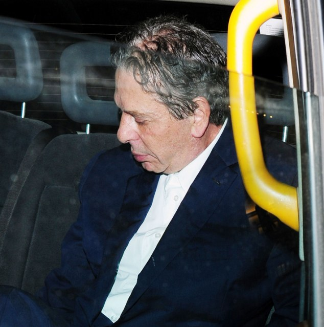 Weary: Charles Saatchi looked dishevelled as he emerged after enjoying a Friday night meal at the very same Mayfair restaurant where he was pictured throttling Ngella