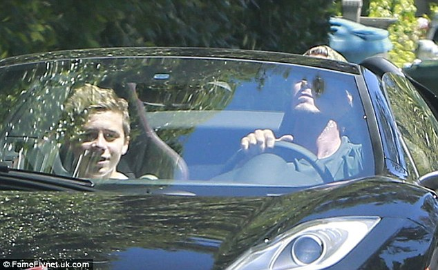 Brooklyn can't stop smiling as rides shotgun in his dad's new sports car