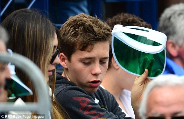 Image conscious Brooklyn immediately takes the sun visor off his head