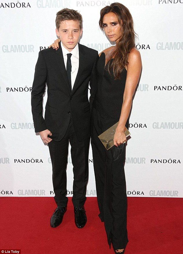 Brooklyn Beckham accompanies mother Victoria to the Glamour Awards in June