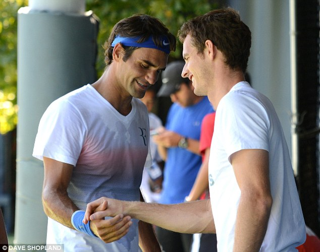 Nice to see you: Murray greets Federer as the pass by each other at Flushing Meadows