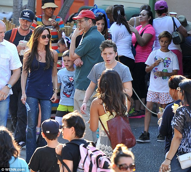The Beckham clan enjoy a day out at Fantasyland in Los Angeles, where they are currently on holiday