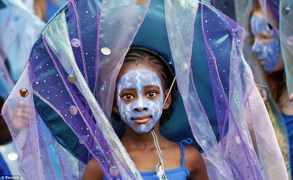 The veil of the ocean: A young girl's sea-themed costume features glittering material sewn into the fabric