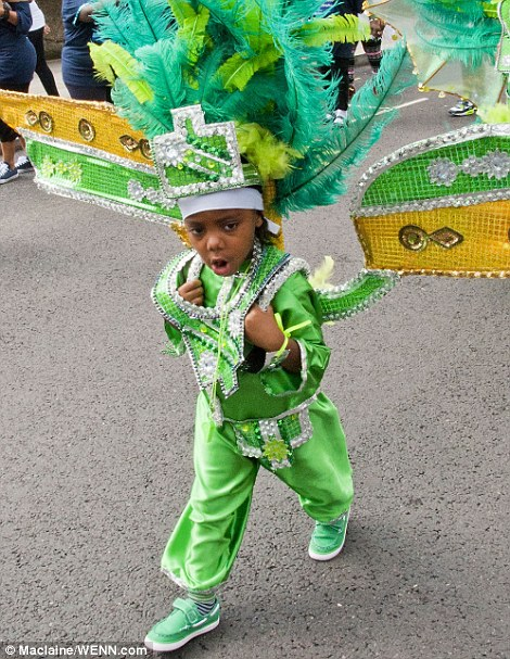 A youngster in a vibrant green costume