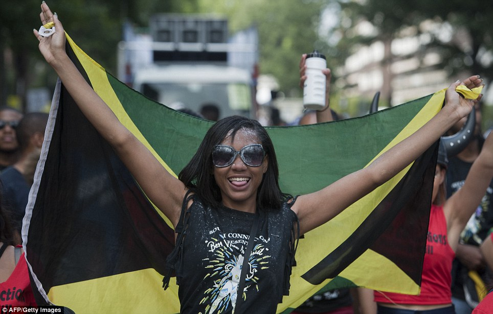 Pride: A performer holds the Jamaican flag aloft as the party gets underway