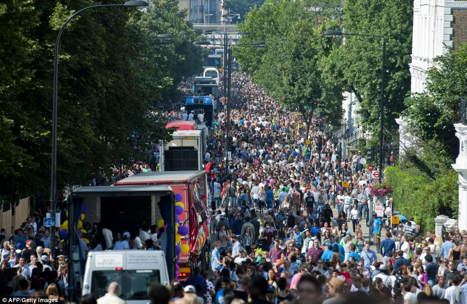 Throngs: Up to one million people are crammed into the streets of West London for the famous annual festival