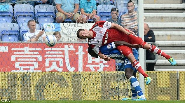 Aerial battle: Jutkiewicz and Wigan's Leon Barnett go head-to-head