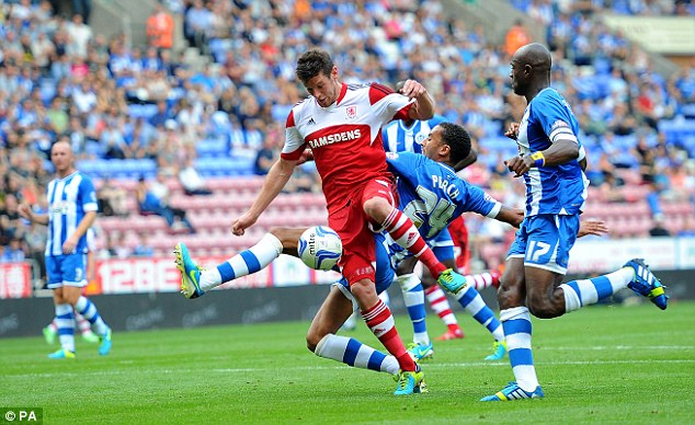 Midfield battle: Middlesbrough's Lukas Jutkiewicz vies for possession with Wigan's James Perch