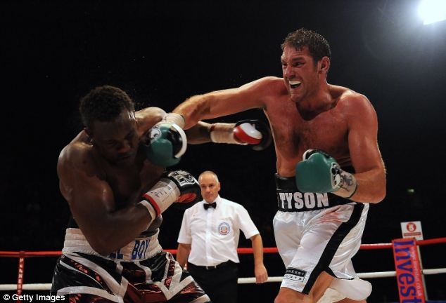 Fury lands a right hand on Dereck Chisora at Wembley Arena in July 2011