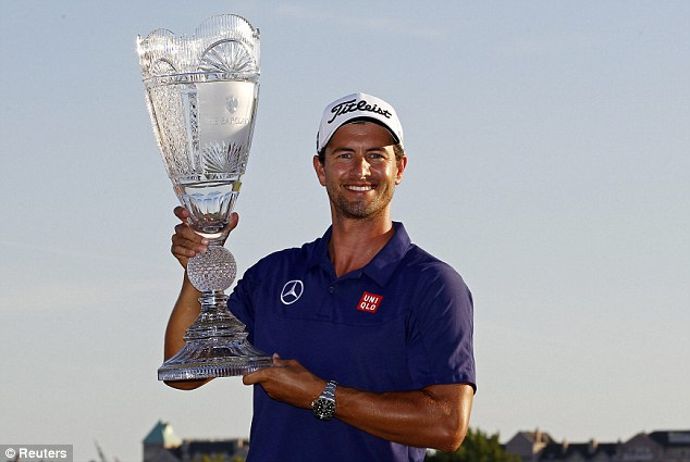 Close: Adam Scott holding the Barclays trophy after winning by a shot from both Justin Rose and Tiger Woods