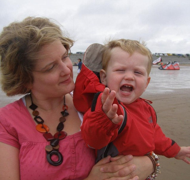 Lucy with Jack at the seaside: Jack drowned in a tragic accident and Lucy's partner, Jack's father, was given just three days off work