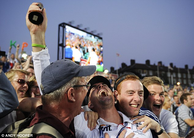 Crowd scene: Pietersen celebrates with the fans at The Oval