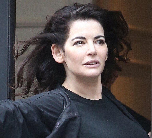 Radiant: Nigella Lawson leaves a hair salon in central London on Saturday looking like a million dollars, before going for a spot of shopping