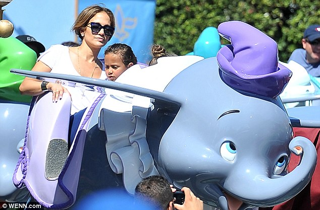 Mommy duty: Lopez got in touch with her inner child and had fun on the theme parks flying Dumbo ride