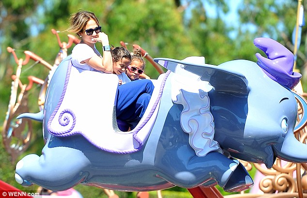 Family fun: Lopez cuddled up to her darlings as they enjoyed the magic of Disneyland together