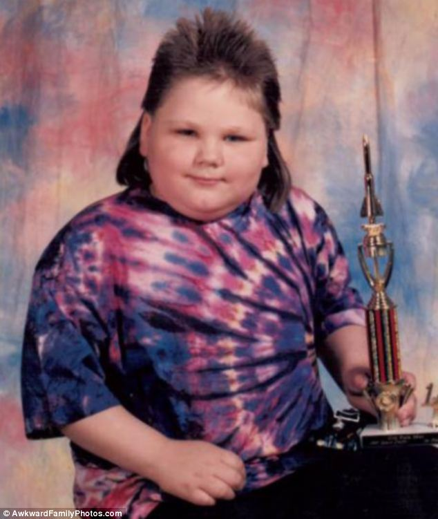 Award winning: This boy celebrates winning a prize by posing with a tie-dye t-shirt and gelled mullet