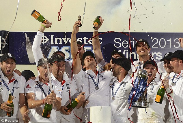 Sweet victory: The England team go berserk last night after winning the Ashes 3-0 following the final test at the Oval