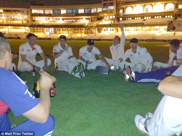 Enjoying the win: Surrounded by alcohol sat on the Oval pitch the England team celebrate - but it was reported today they started urinating on the pitch