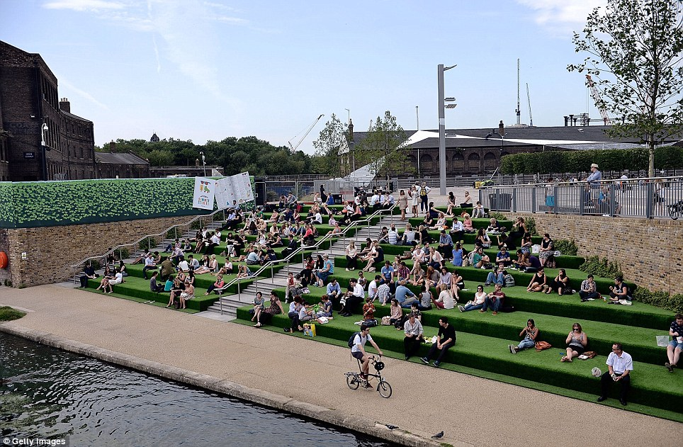 Making the most of it: Revellers soak up some rays before returning to work tomorrow after the bank holiday weekend