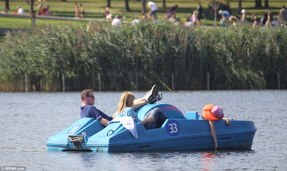 Cooling off: Londoners take in the rays on a peddle boat in Hyde Park yesterday