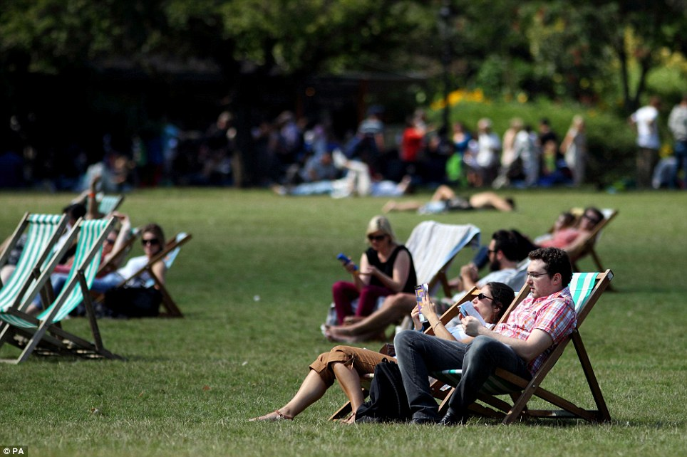 Taking a break: The public enjoy the warm weather in St James's Park, central London, as the country basks in the Bank Holiday Monday sunshine