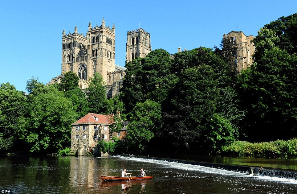 Life is but a dream: Two men take a trip in a rowing boat along the River Wear in Durham - one of many beautiful scenes as Britain basked in sunshine