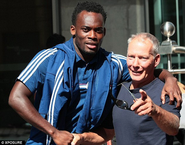 Pointing at the camera: Michael Essien meeting a member of the public