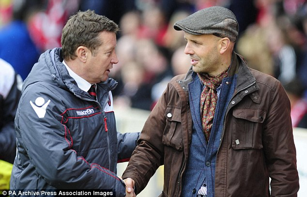 Looking sharp: Exeter boss Paul Tisdale (right) greets Sheffield United's Danny Wilson before a game