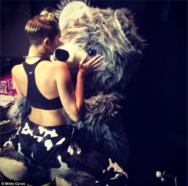 Cosy: The singer straddled a teddy bear as part of her risque act