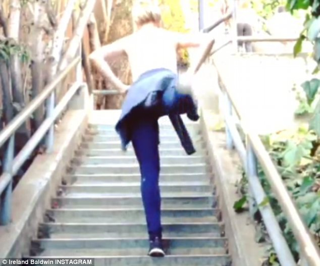 Ireland turned a public stairway into her own private gym as she completed a series of leg lifts