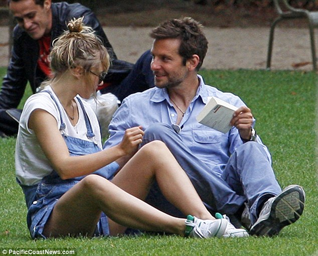 Good spirits: The actor seemed to be in a good mood as he spent time with his British girlfriend
