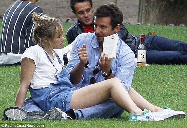 Romantic break: Sitting in a park watching Bradley read was perhaps not her idea of a perfect date