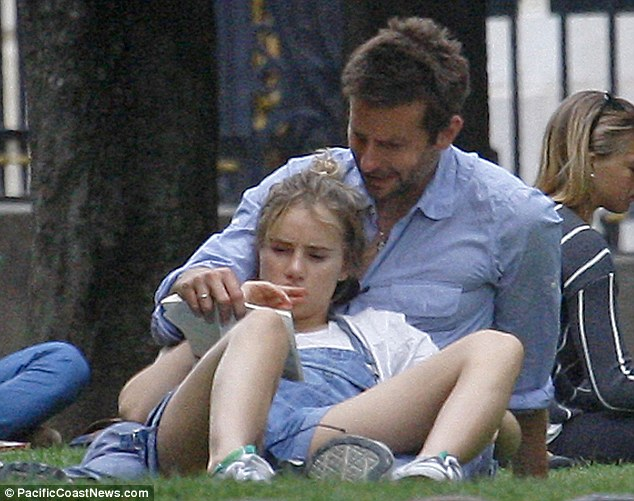 Engrossed: Suki appeared to be reading the book alongside her boyfriend