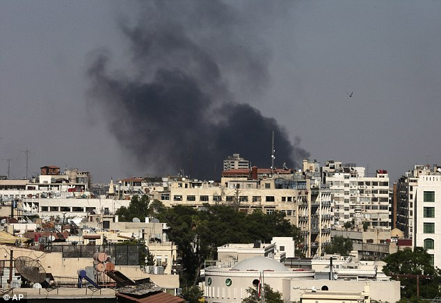 Wreckage: Black columns of smoke rise from heavy shelling in the Jobar neighborhood, east of Damascus, Syria