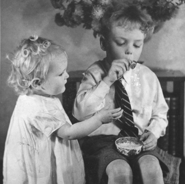 Child's play: Mary is pictured as a toddler, jealous of her brother Roger blowing bubbles