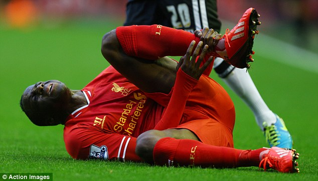 Down and out: Aly Cissokho had to go off injured after just 10 minutes