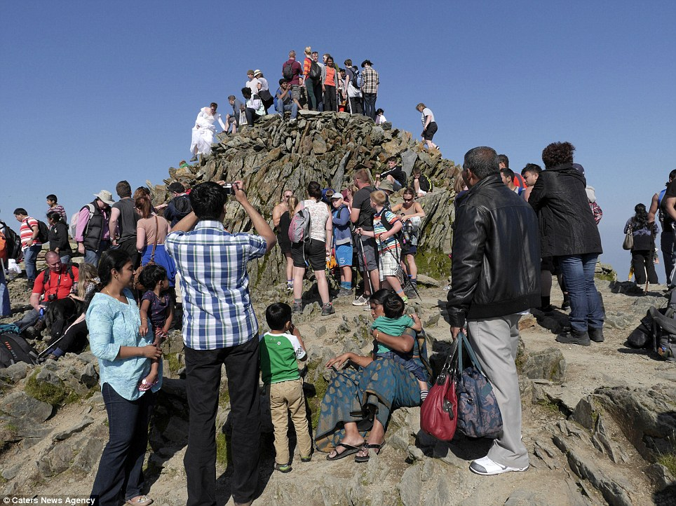 Scores of people queue for the best sun spot on the peak of Snowdon yesterday on the last day of the Bank Holiday weekend