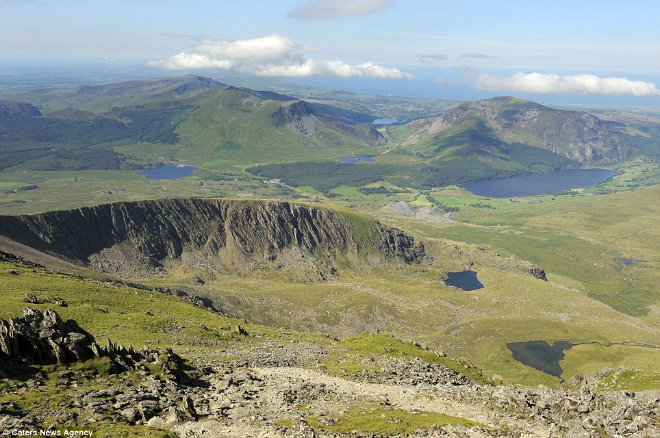 Get in line: Climbers were waiting to get a glimpse of the stunning views from the top of Snowdon in Wales